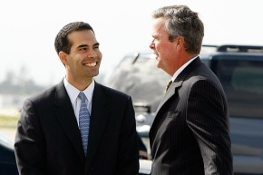 George P. Bush (left) talking to father Jeb Bush.
