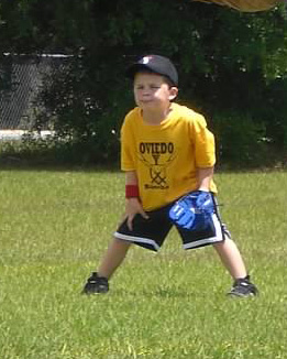 Brendan playing TBall - he was always the most serious of the kids in the field.