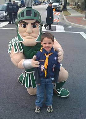 Brendan and Sparty at the Citrus Bowl Parade in Orlando.
