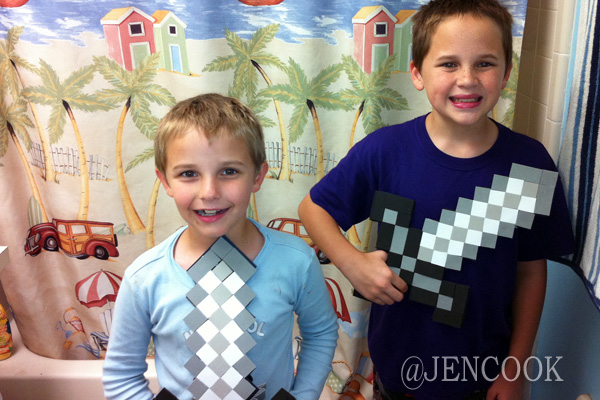 The boys show off the finished Minecraft foam swords.