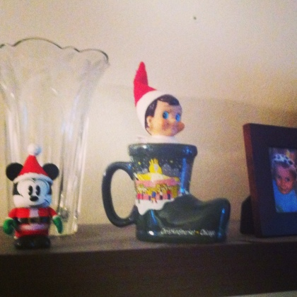 Elf on a Shelf in a Christmas mug.